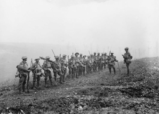 Men of B Company, 29th Battalion, receive an address from their Lieutenant prior to their advance on Harbonnieres (AWM E02790).