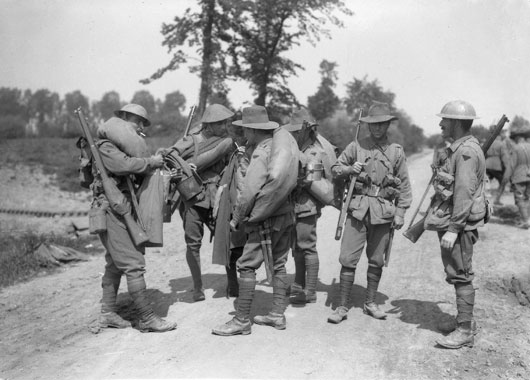 An informal group portrait of six unidentified infantrymen of the 2nd Australian Division (AWM EZ0016).