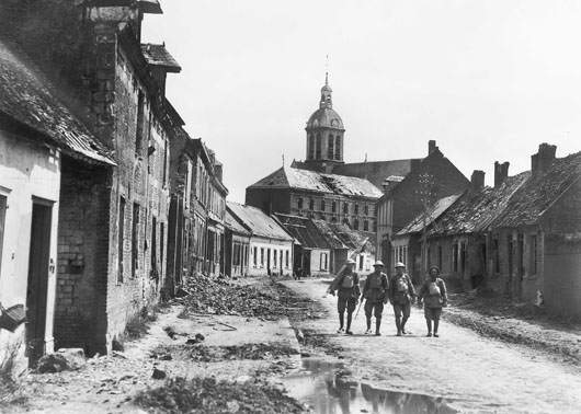 A group of stretcher bearers make their way through the village of Harbonnieres following its capture by Australian troops (AWM E02845).