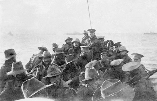 Unidentified men of the 1st Divisional Signal Company being towed towards Anzac Cove at 6am on the day of the landing (AWM A02781).