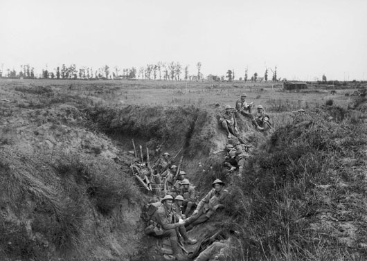 Members of 6th Battalion AIF resting in an old trench during their advance towards Lihons (AWM E02866).