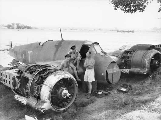 A Beaufighter aircraft being dismantled for overhaul at Arakan, Burma (AWM SEA0052).