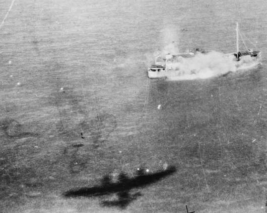 The shadow of an RAF Beaufighter is thrown on the sea as it goes in to attack a Japanese merchant vessel off Elephant Point on the enemy held Burma coast (AWM SUK12576).