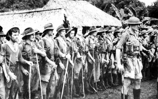 Members of the 39th Battalion parade after weeks of fighting in dense jungle during the Kokoda campaign (AWM 013289).