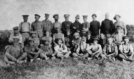 A group portait of the surviving members of D Company, 7th Battalion, after the Battle of Krithia (AWM A03308).