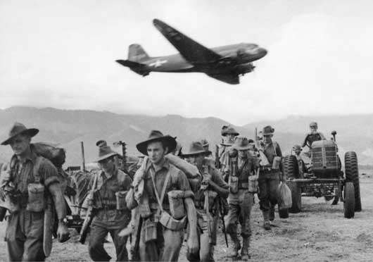 Material being brought in by aircraft as Australian soldiers make their advance on Lae (AWM 015816).