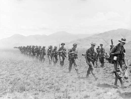 The 2/27th Australian Infantry Battalion, moving forward across the valley (AWM 058650).