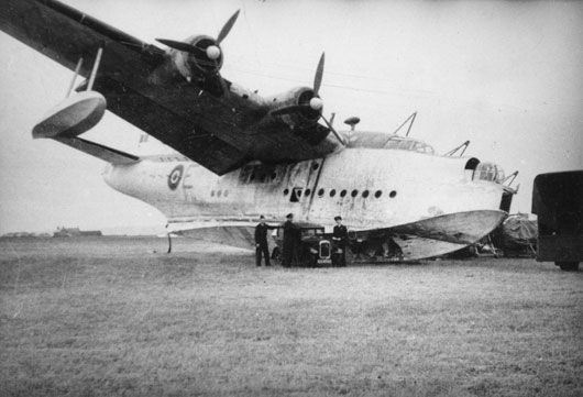 A Sunderland of 461 Squadron RAAF is forced to land on ground due to damage to the hull sustained during a rescue mission in the Bay of Biscay (AWM 045299).