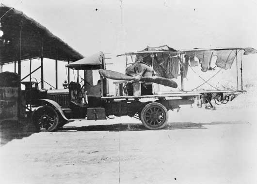 The remains of Lieutenant G.P. Merz's Caudron being transported on the back of a truck after it had been hacked by hostile Arabs during a forced landing (AWM A02264).