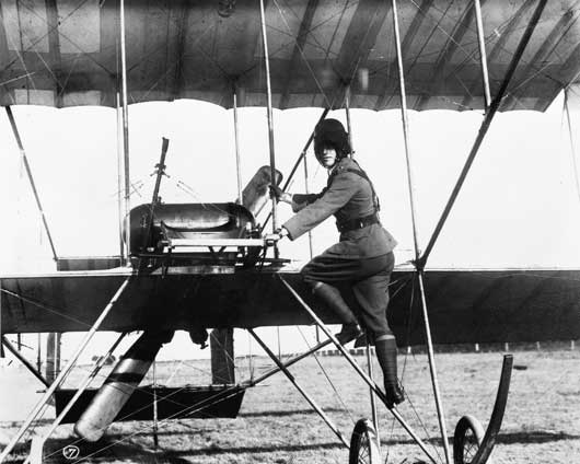 Lieutenant George Pinnock Merz climbing aboard a Bristol Boxkite aircraft, during training at Point Cook, Victoria in 1914 (AWM A03918).