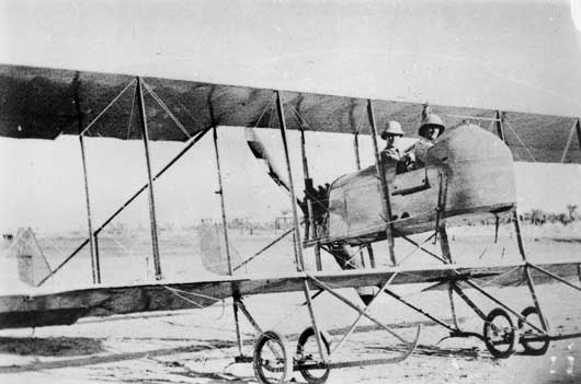 Two unidentified members of the Half Flight seated in a Maurice Farman Shorthorn aircraft (AWM A04136).