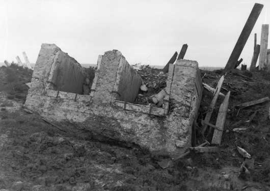 A German pillbox, overturned by the explosion on Messines Ridge (AWM E01269).