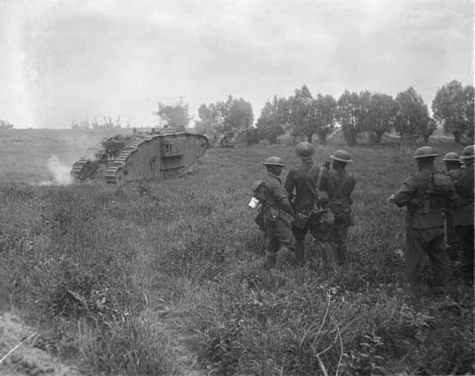 Unidentified New Zealanders watching the tanks advancing towards Messines Ridge (AWM E01417).