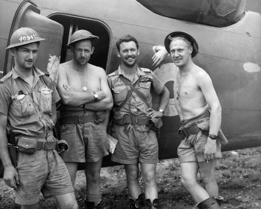 The happy crew of a 6 Squadron RAAF Lockheed Hudson after their return from attacking Japanese destroyers which had been shelling Australian positions in Milne Bay (AWM 026596).