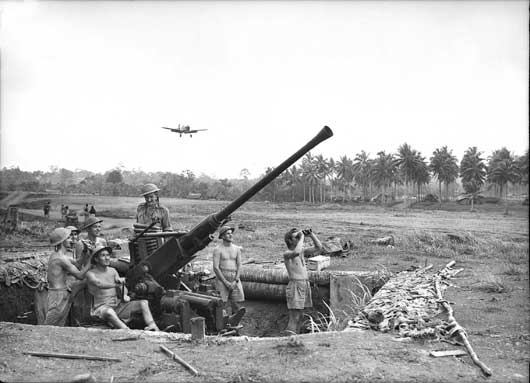 A Bofors 40mm anti-aircraft gun on the main fighter runway at Gili Gili airfield (AWM 026629).