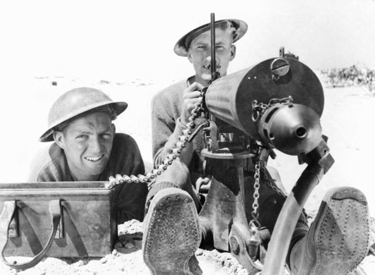 A machine gun and its crew in the Western Desert (AWM 013660).