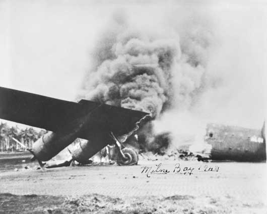 An American Liberator aircraft, which made a forced landing at Milne Bay, set on fire by Japanese dive bombers (AWM 044665).