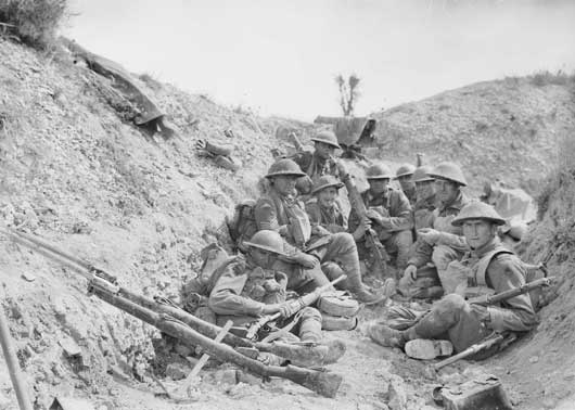 Members of the 24th Battalion in a trench, awaiting the lifting of the artillery barrage before the renewed attack which led to the capture of Mont St Quentin (AWM E03138).