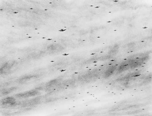 Nearly 100 Lancasters of RAF Bomber Command en route to attack enemy positions in Normandy and Brittany (AWM SUK12676).