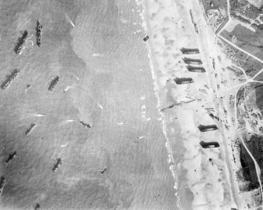 An artificial harbour formed by shipping off the Normandy coast at Arromanches (AWM SUK13292).