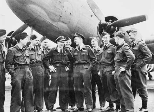 Informal group of RAAF air crew who flew the wounded back from the Normandy battlefield in Transport Command Douglas C47 Dakota aircraft (AWM UK1690).