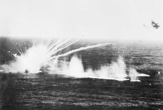 An armed trawler explodes in the North Sea, following attacks by cannon fire from aircraft of 455 Squadron RAAF (AWM SUK12168).
