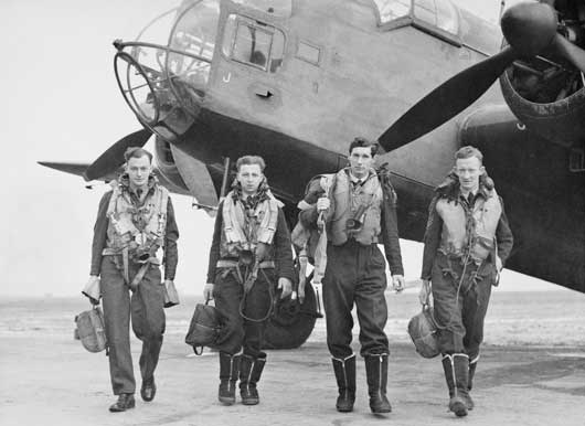 "At a Coastal Command airfield in Scotland, the crew of ""H"" for Harry of 455 Squadron RAAF leave their Hampden torpedo bomber after completing a test flight (AWM UK0170)."