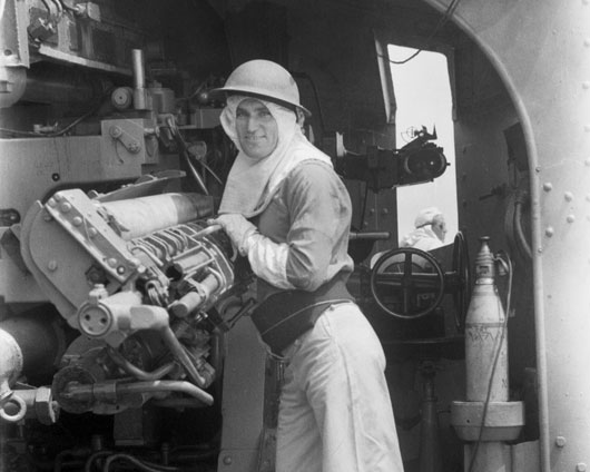 Able Seaman J. Boyle, a gun layer, on HMAS Nizam during a strike against Japan (AWM 121194).