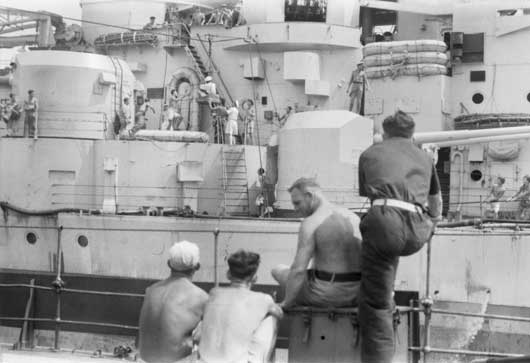 Transferring personnel from HMAS Nepal to HMS King George V, at sea off Japan (AWM 121238).
