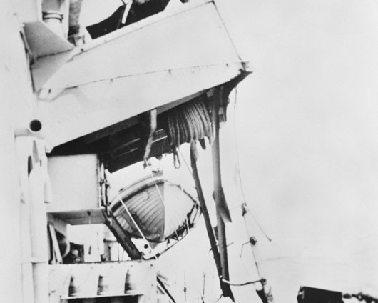 The damaged port wing of the bridge of HMAS Pirie after a collision off Okinawa with HMS Swiftsure (AWM P01185.004).