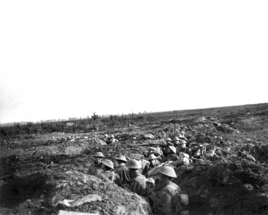 The 24th Battalion in trenches near 'Flinte Farm', with Celtic Copse visible in the background (AWM E00918).