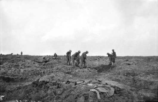 A fatigue party of English soldiers attached to the 3rd Division burying the men killed in the abortive attempt to capture Passchendaele Ridge on 12 October (AWM E01042).