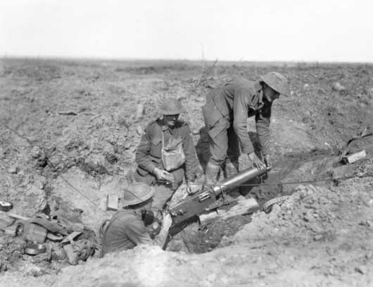 Three Australian machine gunners inspecting a captured German MG08 machine gun (AWM E00779).