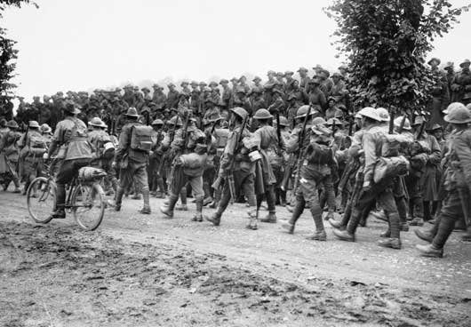 Infantrymen of the 6th Brigade, 2nd Australian Division, march back to their billets after a spell of duty in the front line trenches (AWM EZ0092).