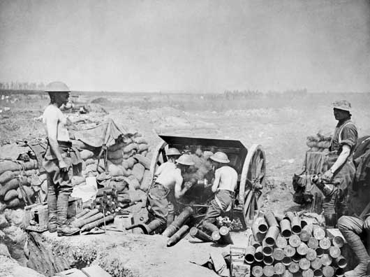 Gunners of an Australian battery use an 18 pounder British field gun to rain 'barrage fire' on the enemy trenches (AWM EZ0141).