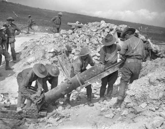 Members of an Australian trench mortar battery preparing to fire their heavy trench mortar in the Chalk Pit (AWM EZ0149).