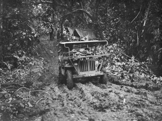 A Jeep ambulance assisting in the evacuation of wounded personnel of the 14/32nd Infantry Battalion from Rabaul (AWM 079862).