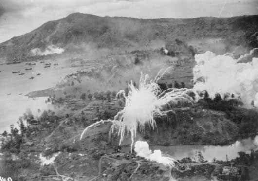 An aerial photograph of bombing raids on Japanese shipping in Simpson Harbour, Rabaul (AWM 101146).
