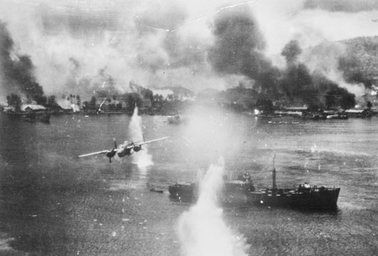 Allied air forces striking Japanese shipping in the harbour at Rabaul (AWM P00240.024).