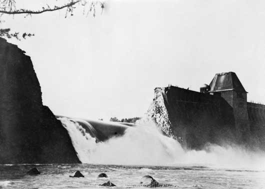 Water pouring from Mohne Dam in Germany, six hours after a successful bombing attack by 617 Squadron RAF (AWM 128223).
