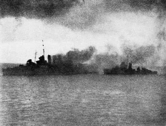 HMAS Canberra on fire, with a US destroyer standing by, after torpedo and gunfire attacks by Japanese planes (AWM P02018.132).