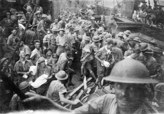 Troops on the deck of the cargo vessel Empire Star, which evacuated 2,514 people from Singapore to Batavia and was damaged by Japanese bombing (AWM P01117.008).