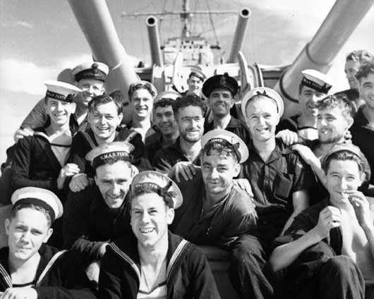 A group of happy crewmembers relaxing on HMAS Perth (AWM 006846).
