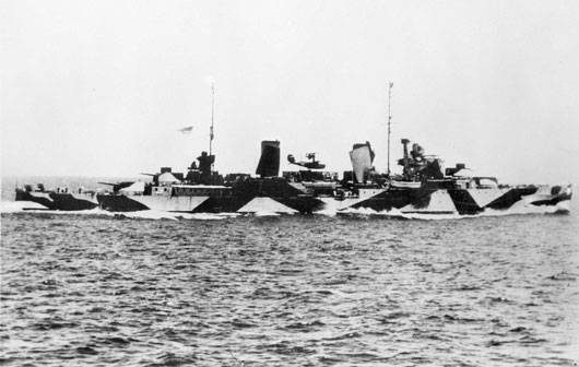 A starboard side view of HMAS Perth, showing its camouflage scheme (AWM 301160).