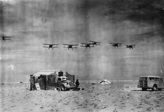Gloster Gladiator aircraft of 3 Squadron RAAF returning to land after a patrol over Bardia, before the battle (AWM 042275).