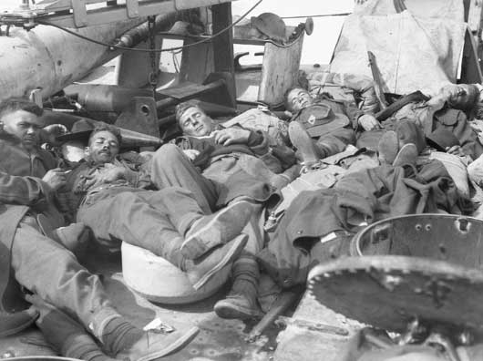 Australians of the 9th Division take a well-earned rest during their evacuation from Tobruk to other Middle East ports by units of the Royal Navy (AWM 021154).