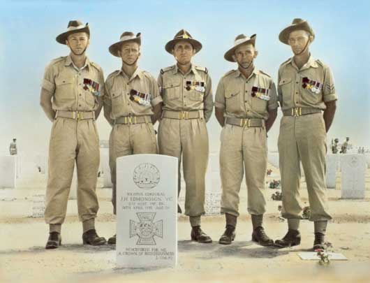 Five Victoria Cross winners of the Australian and New Zealand Coronation Contingent in the Tobruk war cemetery, standing behind the grave of J.H. Edmondson (AWM P01895.001).