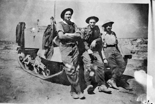 Members of the Bren Gun Carrier Section, 2/48th Battalion, two days before the raid on Carrier Hill during the seige of Tobruk (AWM P02688.001).