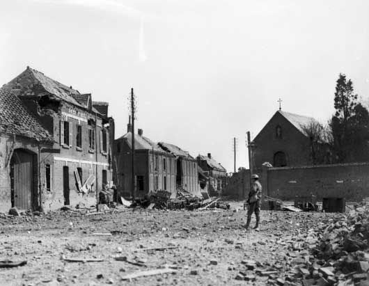 The remains of a barricade in a street at Villers-Bretonneux, after the town was recaptured by Australians (AWM E04880).