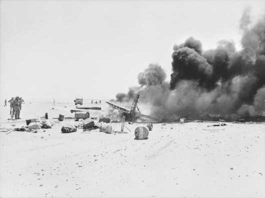 A Hurricane fighter aircraft shot down near El Alamein, bursting into flames (AWM 024475).